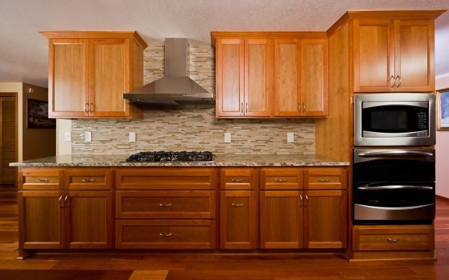 light wood kitchen cabinets with gas stove