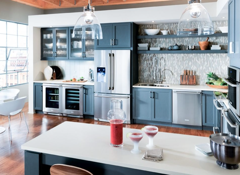 modern blue kitchen with white countertops
