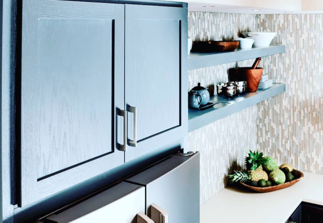 blue kitchen cabinets, zoomed in on the top cabinets above the refrigerator
