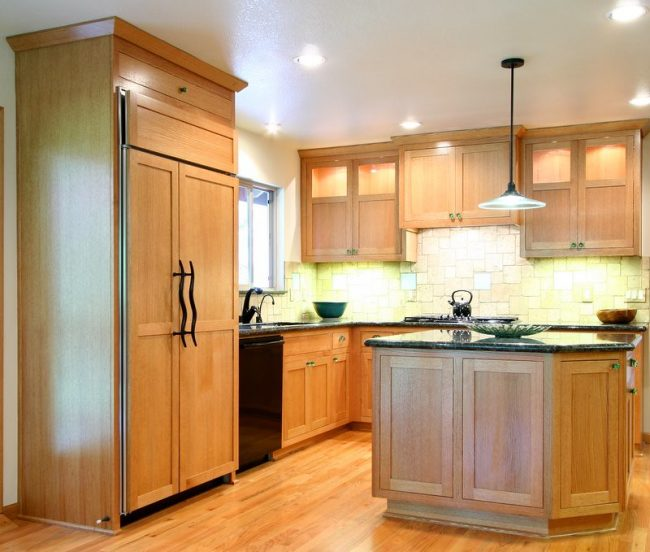 custom wood look monochromatic cabinets with black countertops