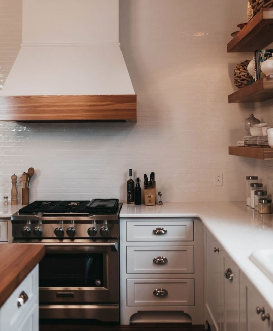 farmhouse inset cabinets with brown or wood countertopcs