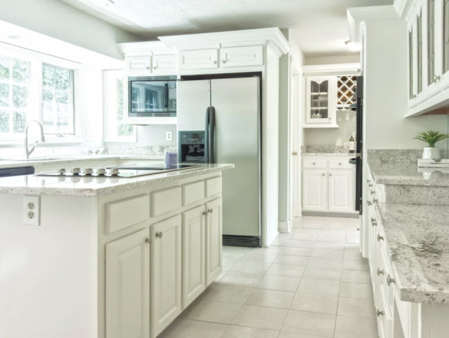 white partial overlay cabinets and stainless steel appliances